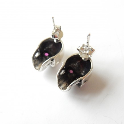 Photo of Sterling Silver Ruby Skull Stud Earrings