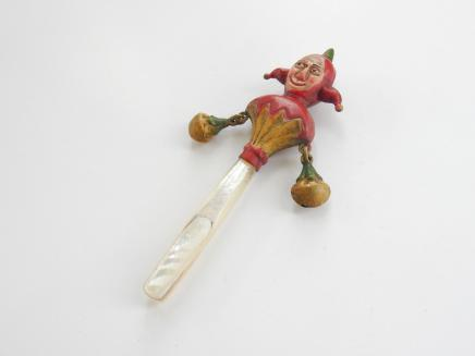 Photo of Hand Painted Brass Punch Baby Rattle