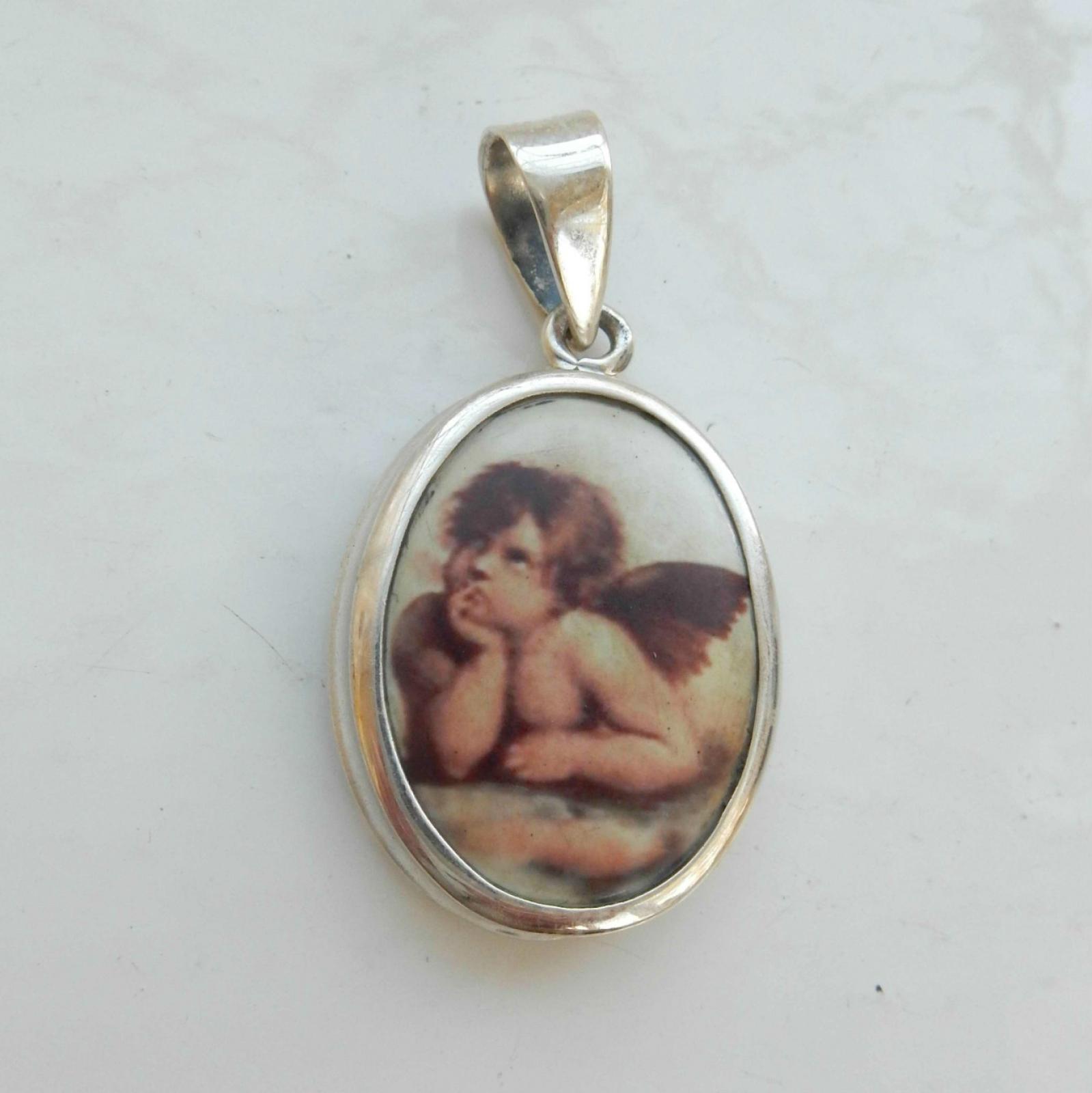 Photo of Solid Silver Cherub Pendant