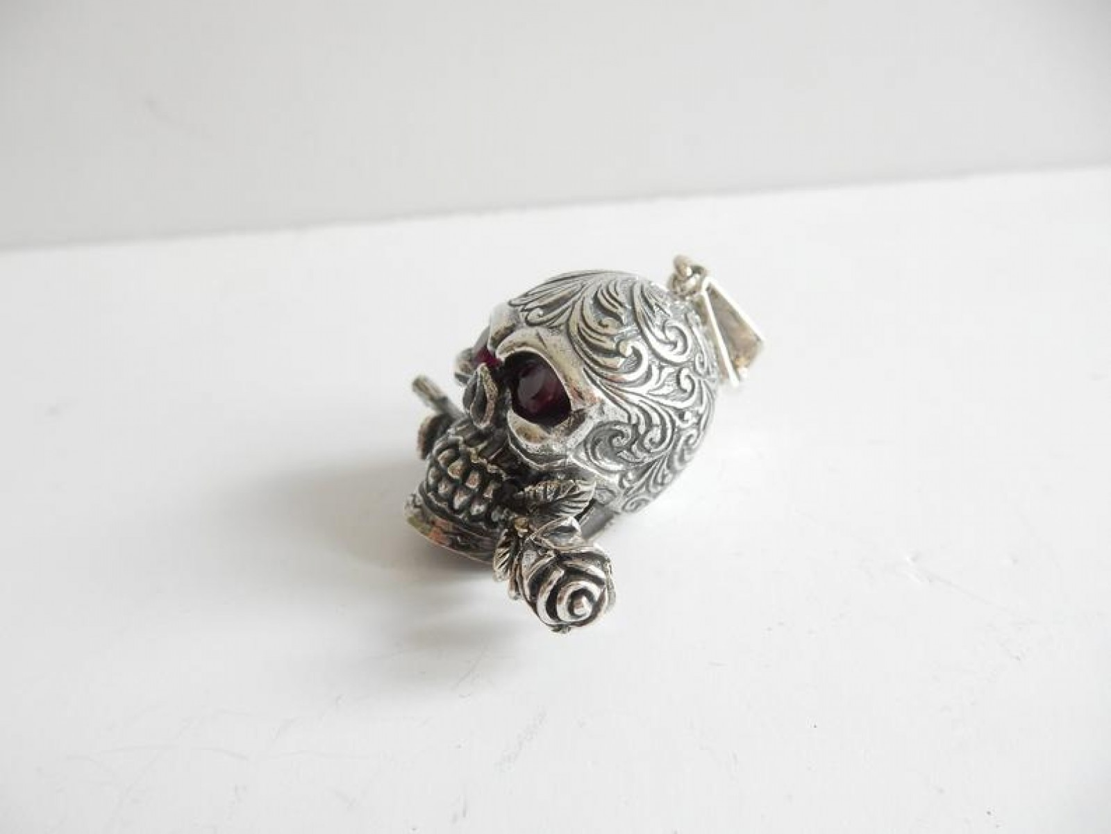 Photo of Silver Ruby Skull with Rose Pendant