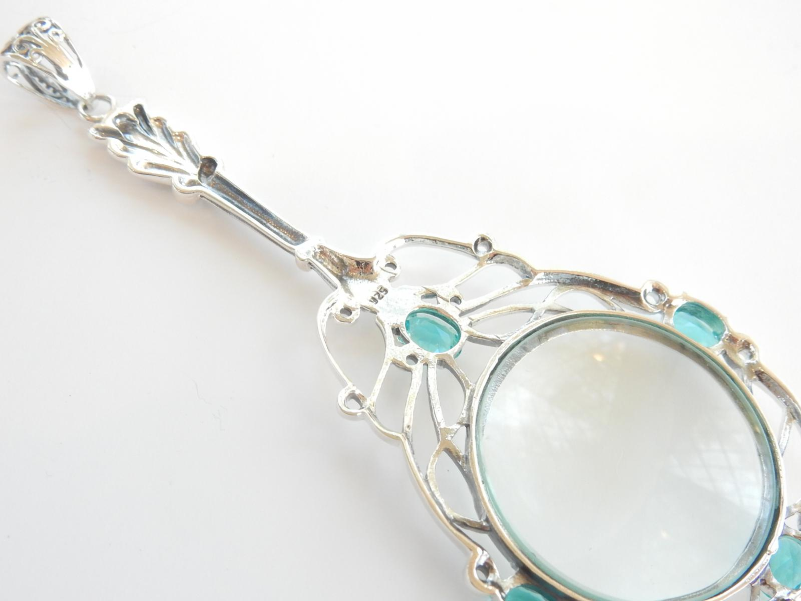 Photo of Solid Silver Blue Topaz Magnifying Glass Pendant